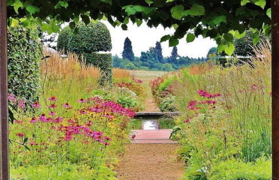 Walled garden with prairie plantings and water rill at Broughton Grange Garden